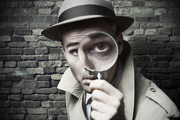 Detective looking through magnifying lens