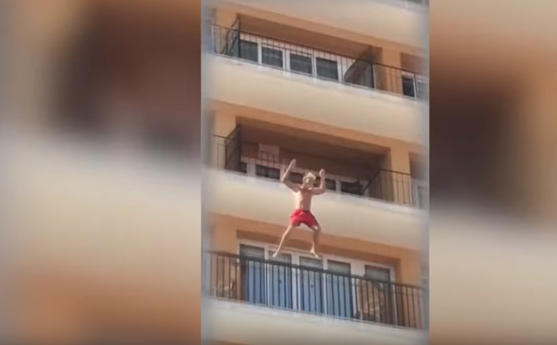 man jumping off balcony