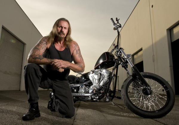 "Rusty Coones, owner of Illusion Cycles, is shown with the 2010 Hellrazor S/T built for the Wounded Warriors Foundation by Kurt Sutter, creator of ""Sons of Anarchy"" and Illusion Cycles and FX. ///ADDITIONAL INFORMATION: WHEELSRustyCoones.1207 – 12/4/12 – LEONARD ORTIZ, THE ORANGE COUNTY REGISTER – Rusty Coones, owner of Illusion Motorcycles in Westminster, built the bikes in the hit FX Show, 'Sons of Anarchy.' Also photographed, co-owner, K.O. Coones."