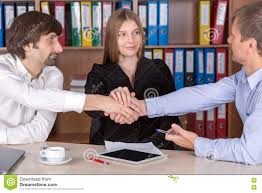 3 people shaking hands